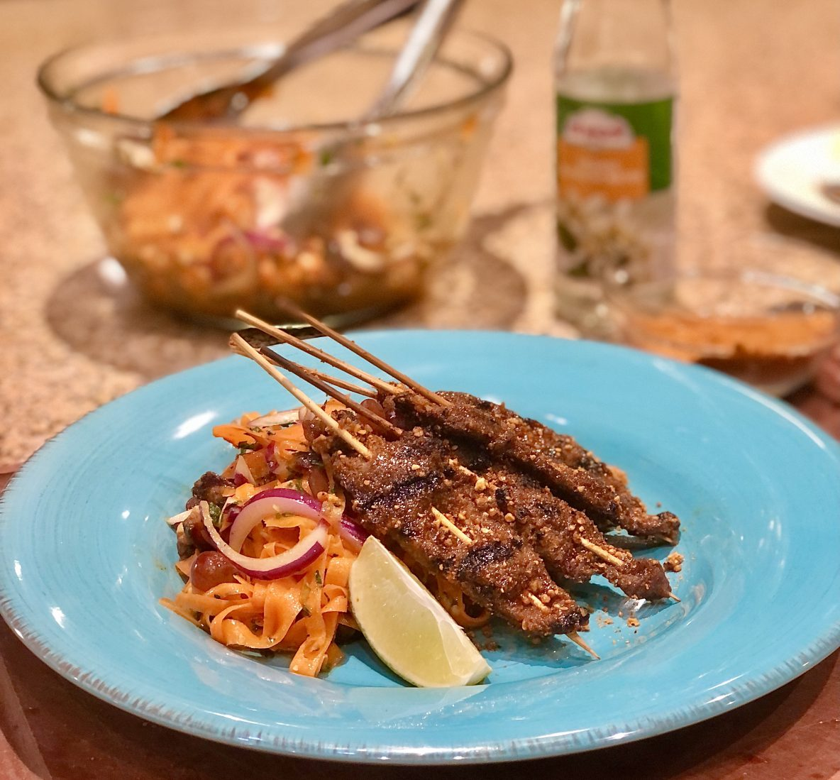 Picture of beef skewers with carrot salad